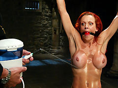 Hot Pussy, In a cold lonely factory a young bondage slut is tied and sprayed