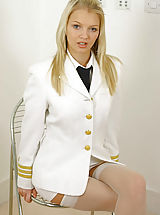Secretary Pics: Sexy blonde Sam in pilots uniform with stockings