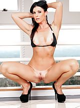 India Summer Pretty Female exposes her naked boobs, pulls down her underwear and spreads her thighs and masturbates her wet cunt