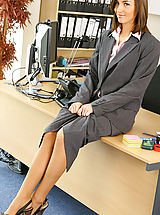 Only Tease Pics: Melanies perfect figure is flattered by the sexy lingerie under her suit skirt and blouse