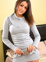 Stunning Bryoni-Kate relaxes on her bed in a sexy tight grey top with black stockings.