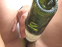 Jacky shoves a bottle in her pussy