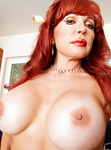 Naughty housewife shows off her big tits and tasty pussy in the kitchen