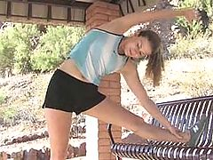 Hottie, Emilie stretches after a jog
