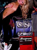 Suze Randall Pics: These two grease up in the garage for some mighty fine tuning, screwing, and lubing.