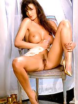 Suze Randall Pics: She's all woman here showing off the exquisite curves nature created.