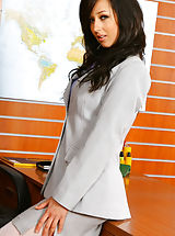 Secretary Babes: Beautiful brunette secretary Laura A strips from her cute grey suit and purple shirt to give us a glimpse of her sexy white lingerie Non Nude