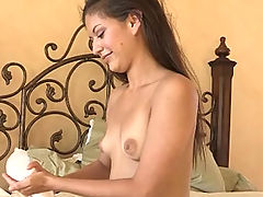 Sofia rubs her ass with lotion