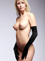Babes Babes: Nicole poses with picture perfect elegance wearing nothing but a pair of black satin gloves.