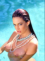 Hard Nipple Babes: Ms. lovely legs Nikki Nova spreads them for you around a rock star's pool.