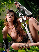 Fantasy Pics: Savage brunette amazon babe with body paintings