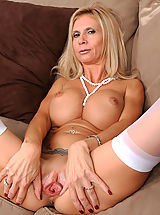 Large Clitoris, Beautiful blonde Anilos lady shows off her big breasts and juicy milf pussy